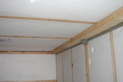 isolation garage mur palissade bois design. Black Bedroom Furniture Sets. Home Design Ideas
