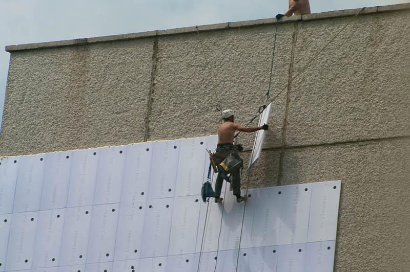 Утепление стены здания при помощи плит THERMIT