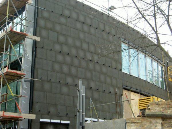 Внешний вид утепленной поверхности, готовой к обшивке фасадными кассетами